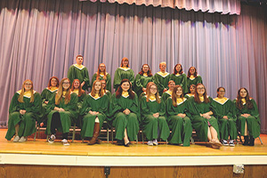 New NHS inductees and returning members pose for a group photo after the NHS ceremony.