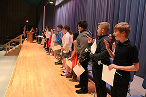 New National Junior Honor Society inductees recite the pledge