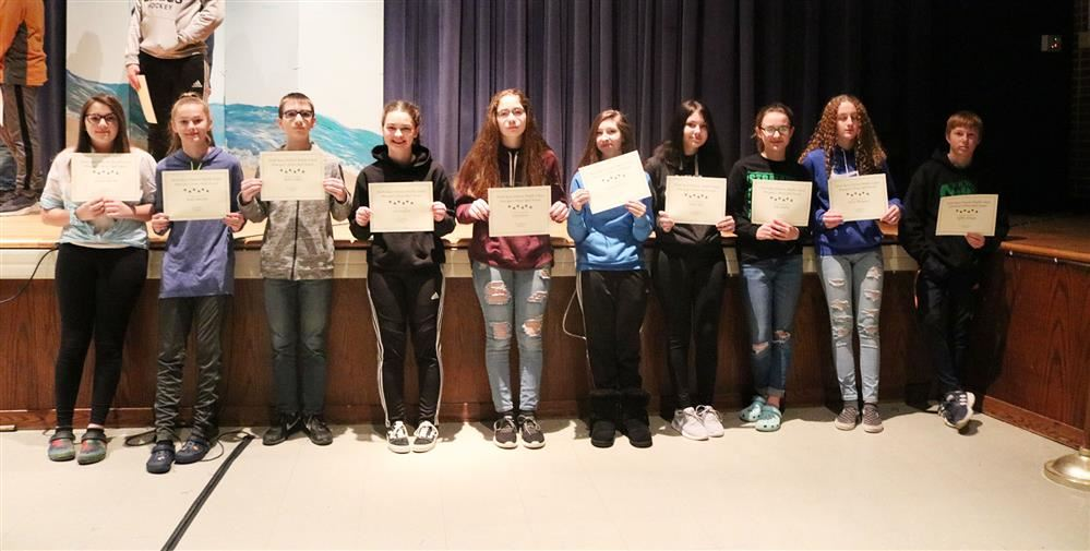Eighth grade principal's honor roll students pose for a photo