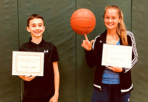 NRW eighth-graders Zach DeRoo and Hanna Stubbe pose for a photo with their awards.