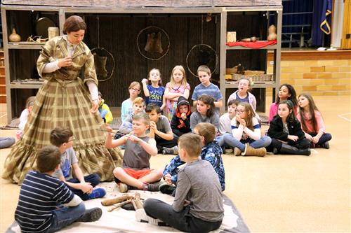 Merry-Go-Round Playhouse acts performance for elementary students.