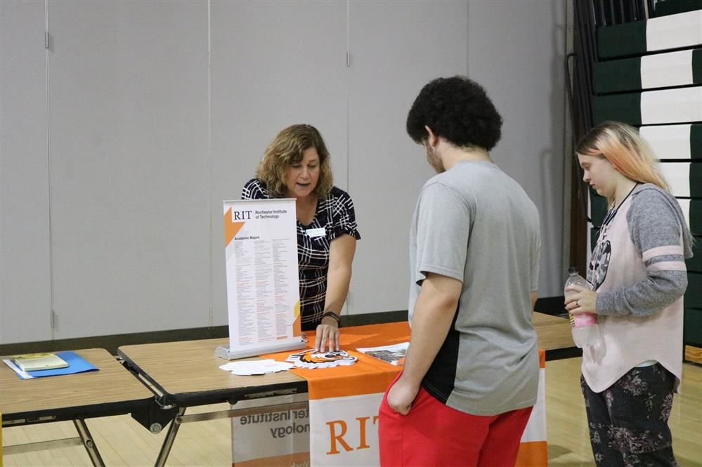 Students speak to a RIT representative at the fair.