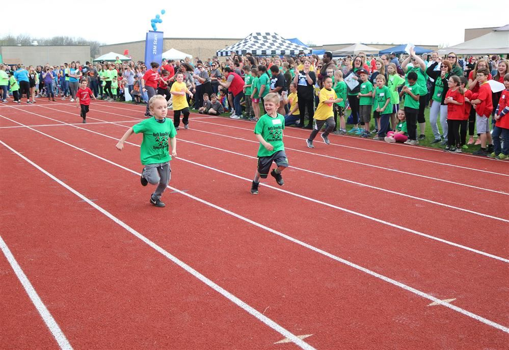 Students compete in the 25-meter dash at Special Olympics.