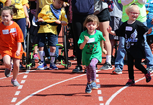 A North Rose-Wolcott Elementary student competes against other runners during the Special Olympics.